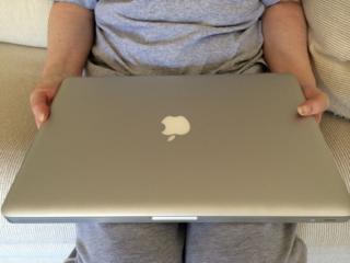 MacBook Pro on the lap of my neighbor